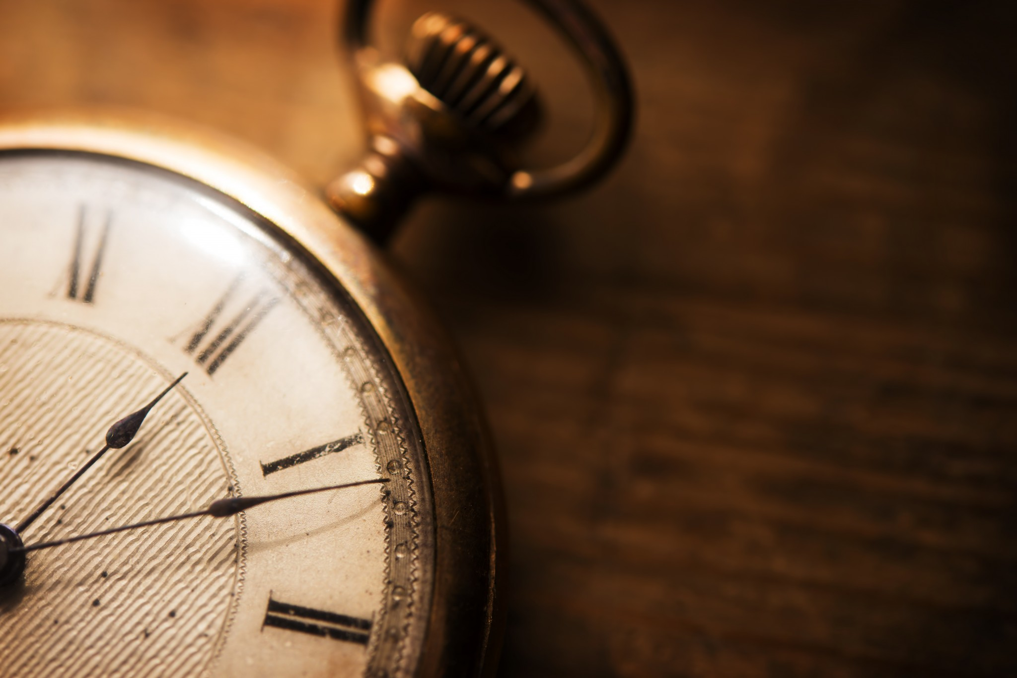 bigstock-Old-pocket-watch-on-grungy-woo-95969576
